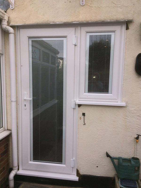 Image 118 - Billericay=White UPVC panel door with blinds