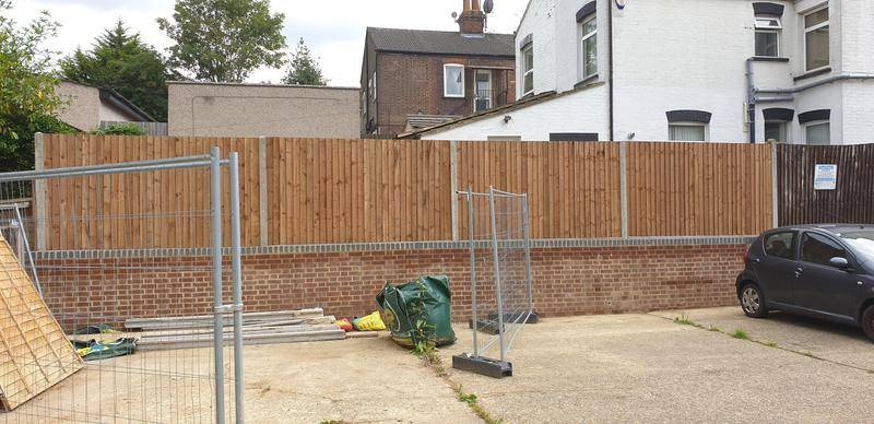 Image 13 - Close board fencing installed behind brick wall