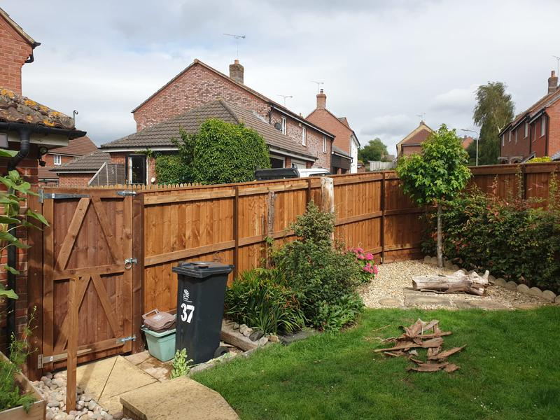 Image 60 - New closeboard fencing in Sturminster Newton using brown tanalised timber.