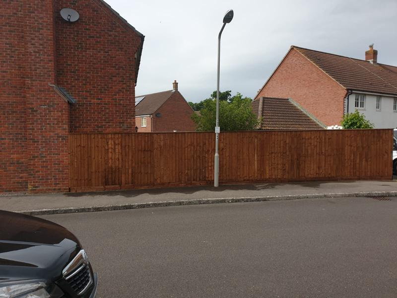 Image 61 - New closeboard fencing in Sturminster Newton using brown tanalised timber.