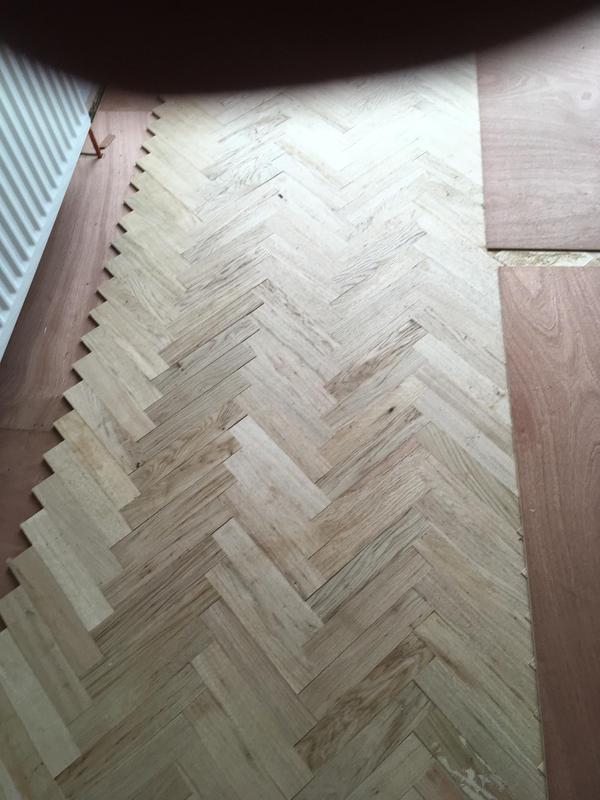 Image 23 - Herring bone parquet being fitted on 6mm ply
