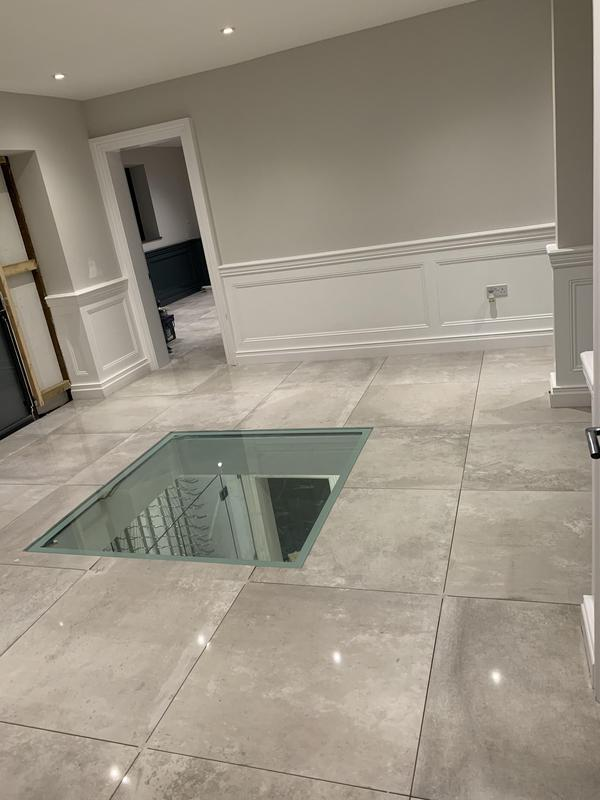 Image 21 - New build with glass floor looking into basement