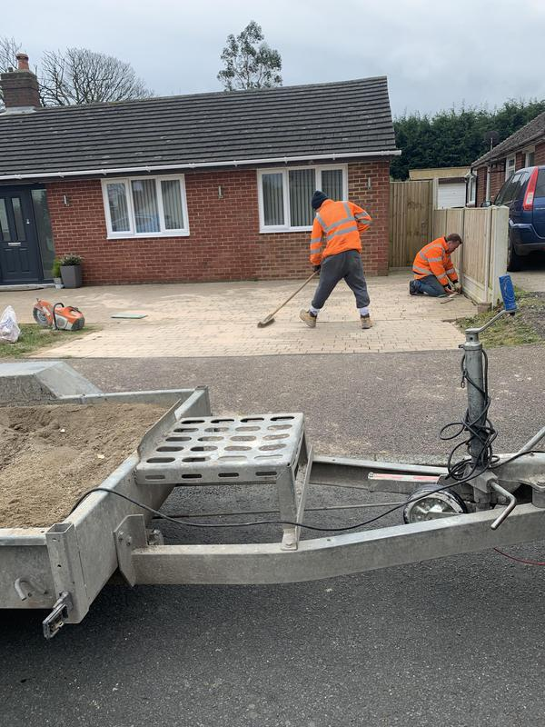 Image 8 - Brushing in Kiln Dried sand to completed Block Paving Driveway in Folkestone.