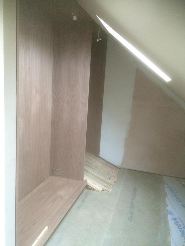 Image 58 - Walk-in wardrobe in attic built from walnut veneered MDF