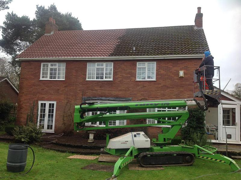 Image 9 - During a pressure washing roof clean, showing the dramatic improvement in appearence!