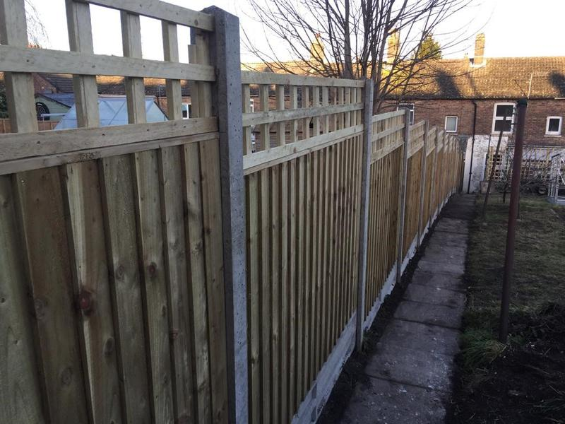 Image 137 - Closeboard fencing on concrete posts with concrete gravel boards and additional trellis