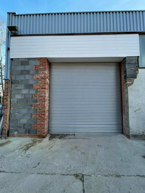 Image 15 - brick wall with security shutter and upvc cladding