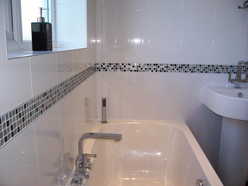 Image 31 - White wall tiles with glass mosaic border.