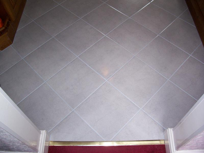 Image 30 - Diamond pattern with light blue grouting.