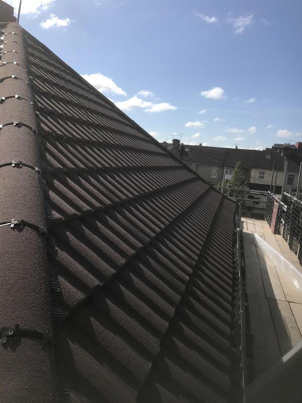 Image 14 - New roof with dry fix hip system