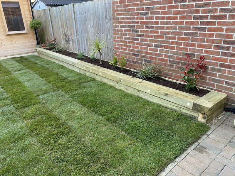Image 9 - 35- after- full planter bed made from sleepers with a mixture of plants