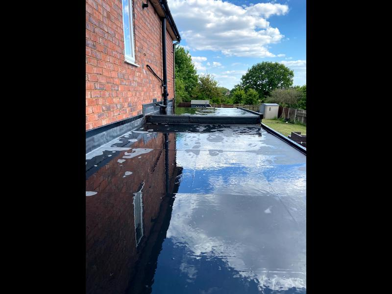 Image 87 - In this image you will see the end result of the installation of Firestone rubber to this customers garage/extension, it was washed down as you see to remove foot mark after installation.