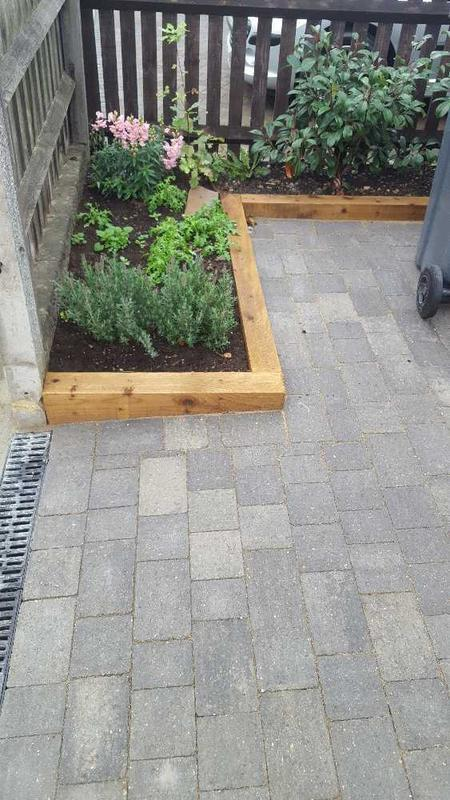 Image 29 - Alfa grey block paving drive with sleeper flower border