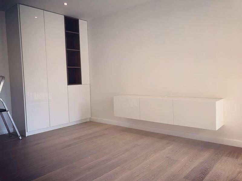 Image 2 - High gloss cabinet with walnut detail and floating tv unit