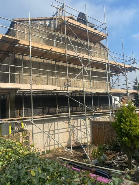 Image 17 - Wooden cladding removed ready for insulation boards.