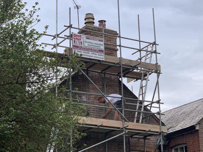 Image 27 - Chimney stack re-pointing on a grade 2 listed property in Guildford Surrey we are skilled in all types of heritage building work and maintenance