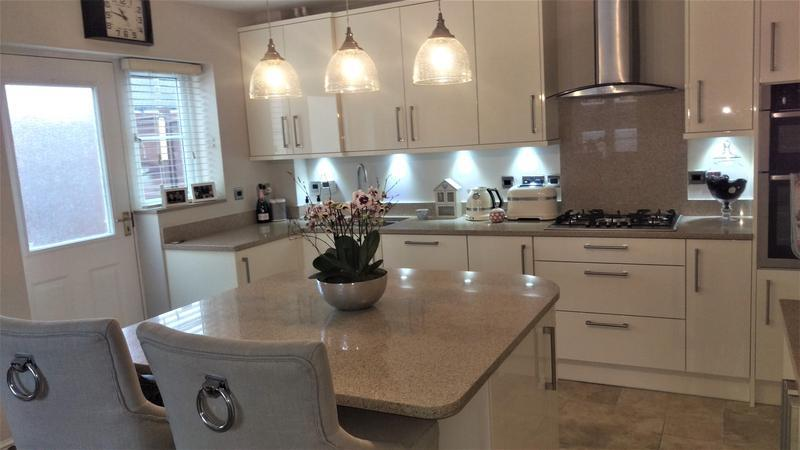 Image 38 - Lifestyle Nova Oyster Gloss Units. Quartz Worktops. Installed in Witney, Oxfordshire.