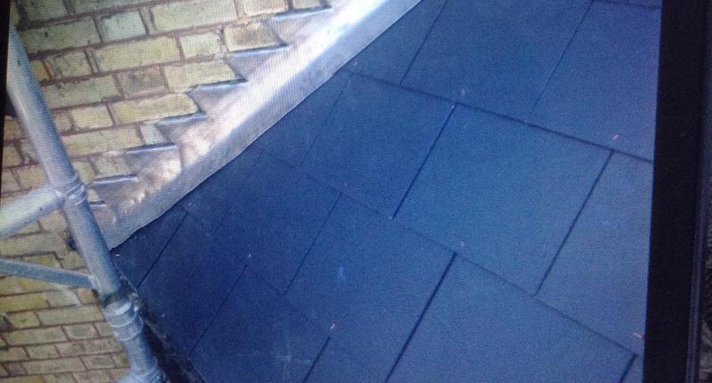 Image 13 - Man made slates with lead step flashing