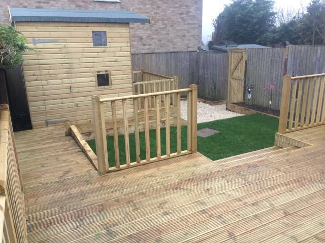 Image 147 - Decking area with hand rail, new turf area and bespoke built childs play house.