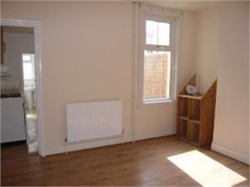 Image 13 - I laid the flooring and painted the walls, skirting and radiator.