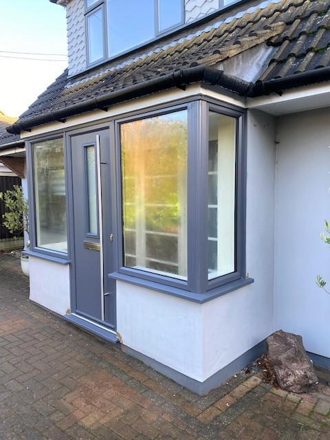 Image 36 - Slate grey composite door and foil windows