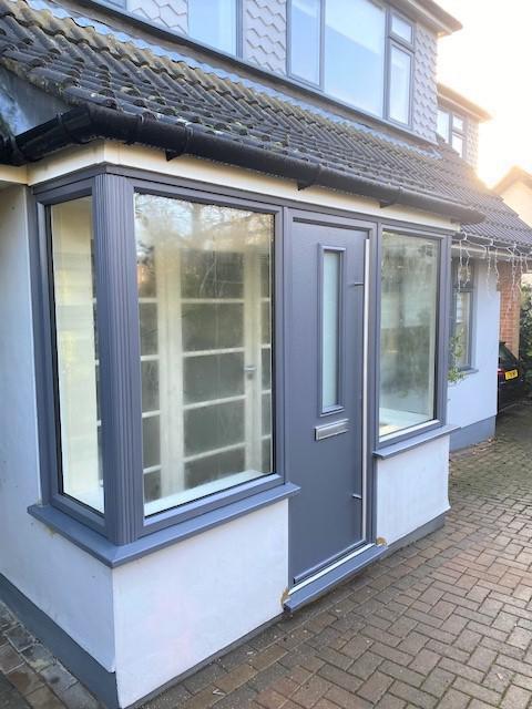 Image 37 - Slate grey composite door and foil windows