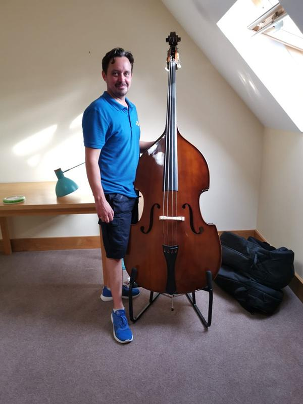 Image 3 - Moving and taking care of a double bass.