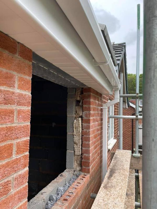 Image 146 - Stoneclough double story extension - During - Brickwork, getting ready for window.