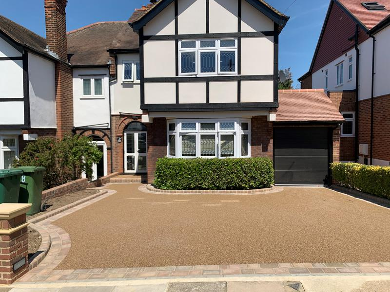 Image 6 - Resin driveway with double paved boarder and decorative brick wall.
