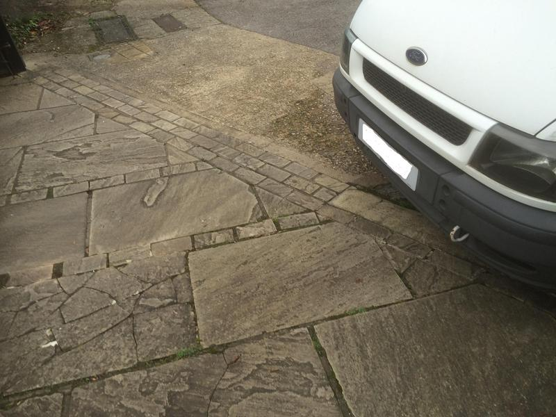Image 79 - Several broken and loose paving stones, large areas of missing pointing
