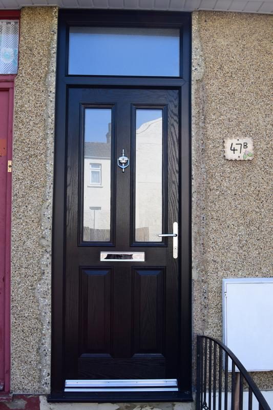 Image 123 - Composite 4 door with over light, in black with black grained frame to match