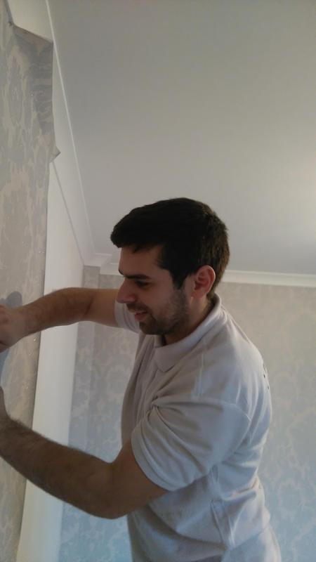 Image 8 - Wallpapering a room. During