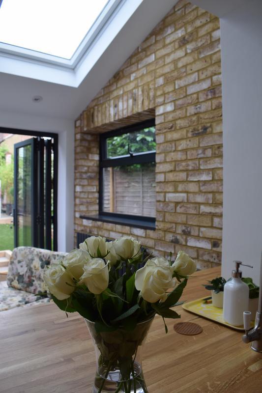 Image 1 - Beautiful brick slip wall inside this single storey extension.