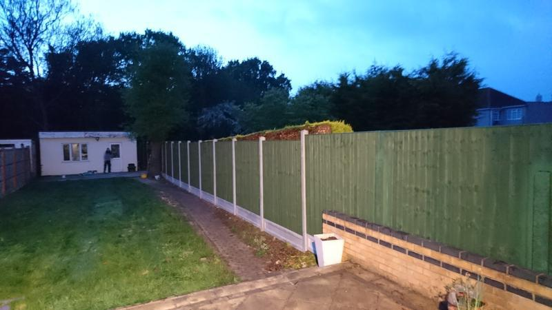Image 28 - 35m of fence fitted including concrete posts and gravel boards