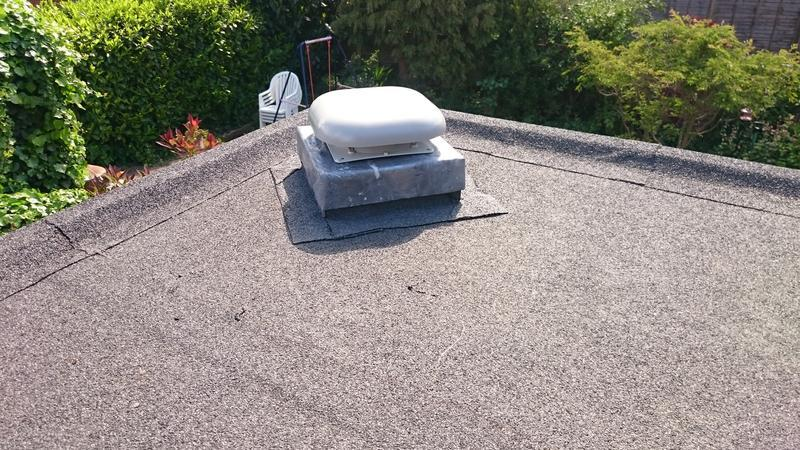 Image 5 - vent flue installed to felt roof