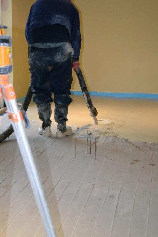 Image 19 - Laying flo screed on heating cables in games room