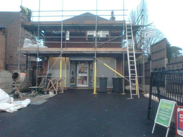 Image 5 - The scaffolding is erected and work begins on the upper floor first