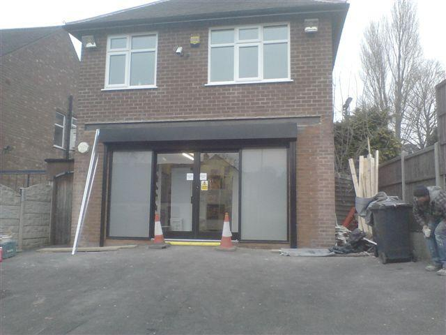 Image 9 - The new doors are fitted in place