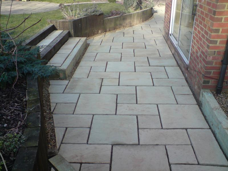 Image 16 - bradstone paving, with sleeper walls and steps