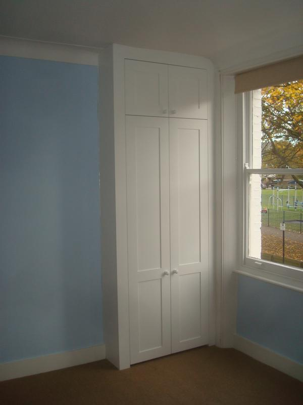 Image 13 - Fitted alcove wardrobe with top box.