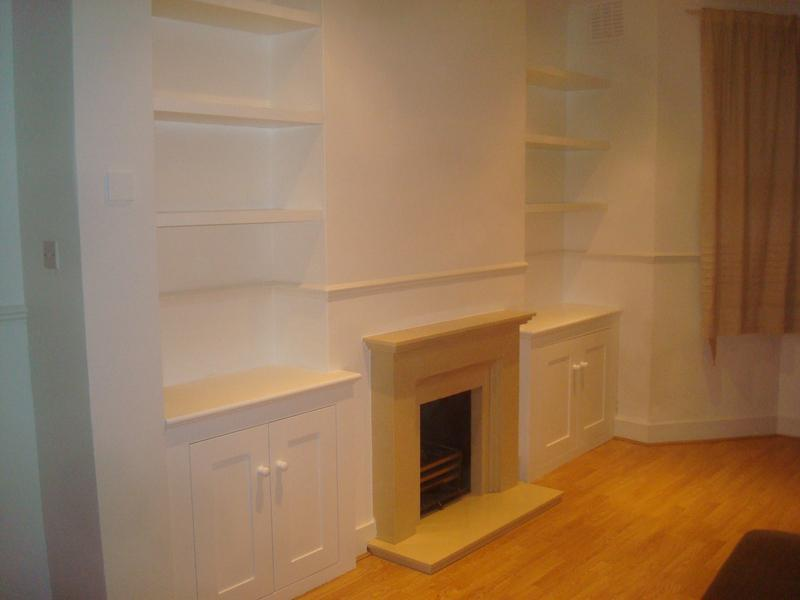 Image 14 - Alcove cupboards with shaker style doors.