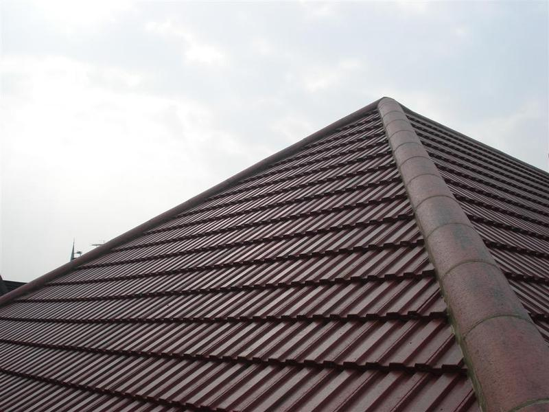 Image 19 - Hips on new roof with concrete interlocking tiles