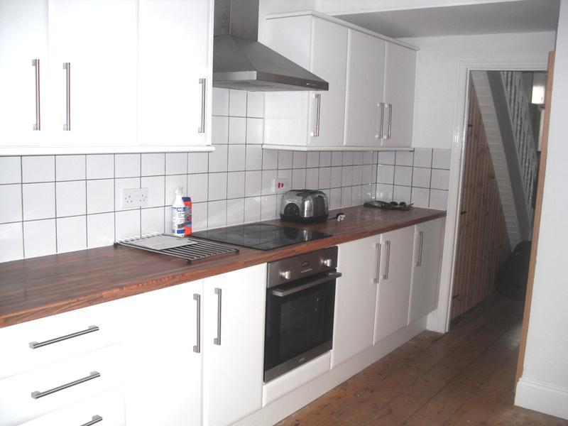 Image 3 - retiling kitchen