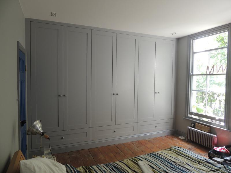 Image 6 - Full wall fitted wardrobe with deep drawers.