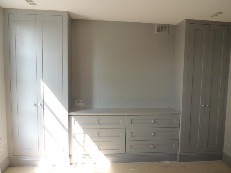 Image 7 - Alcove wardrobes with fitted drawers inbetween all in shaker style.