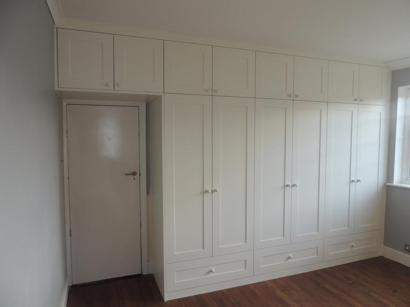 Image 28 - Full wall wardrobe with over door storage.