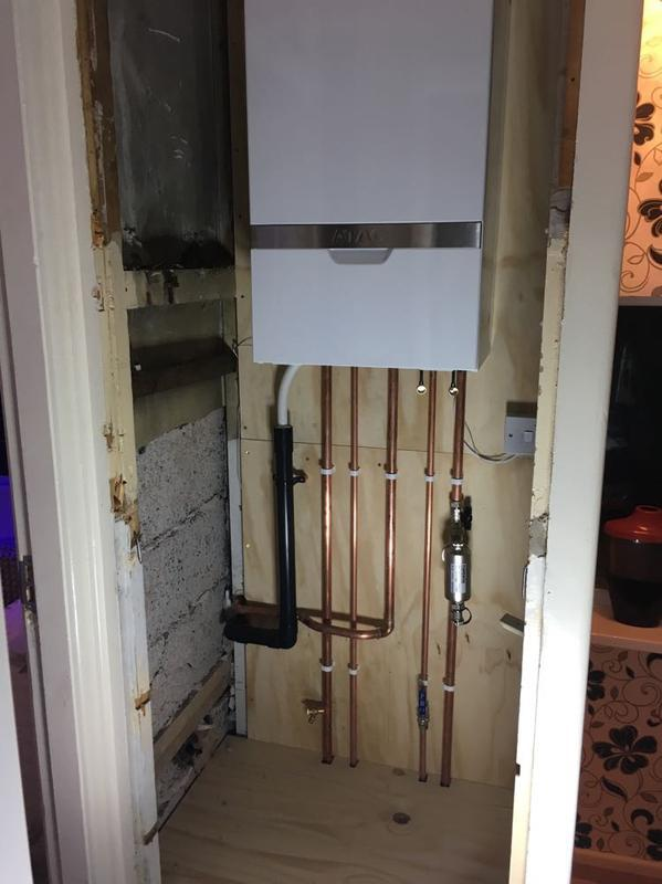 Image 1 - old back boiler removed and an Atag IC installed in the landing cupboard once the tank was removed