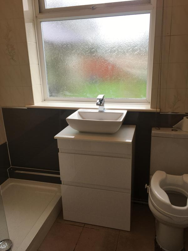Image 23 - Another vanity unit and wall boarded - replacing over the tiles and old basin and pedestal, also bath out and shower tray in