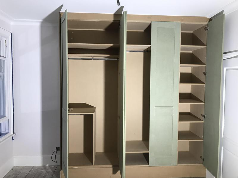 Image 12 - A mixture of shelves and hangers