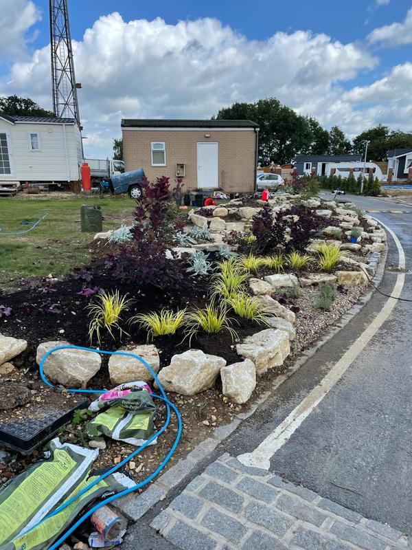 Image 2 - Bespoke Rockery - brick work and flowers provided by us!